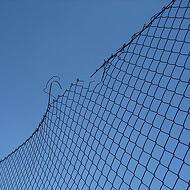 102792-stock-photo-sky-blue-broken-fence-wire-destruction
