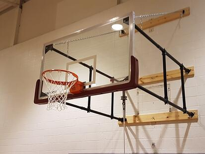 side-folding-wall-mounted-basketball-system-university-of-ottawa