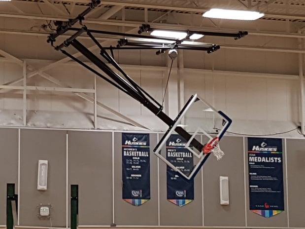 side-folding-ceiling-suspended-basketball-system