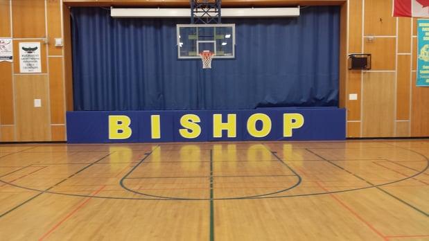 Bishop-Smith-catholic-school-stage-padding-with-logo