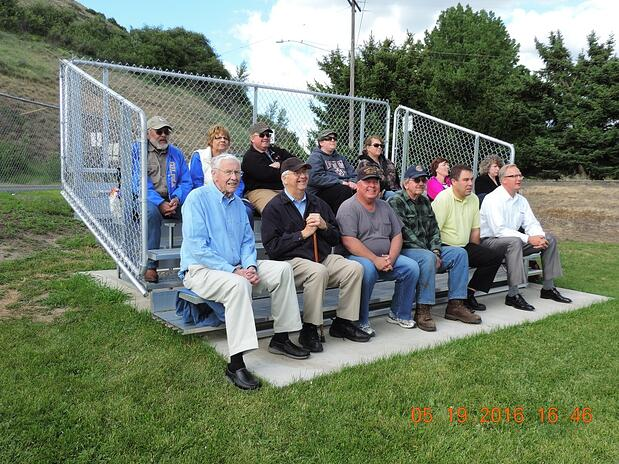 volunteers-from-Colfax-Rotary-Club-sit-on-their-new-bleachers