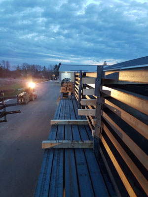 bleachers-on-flatbed-truck-for-shipping