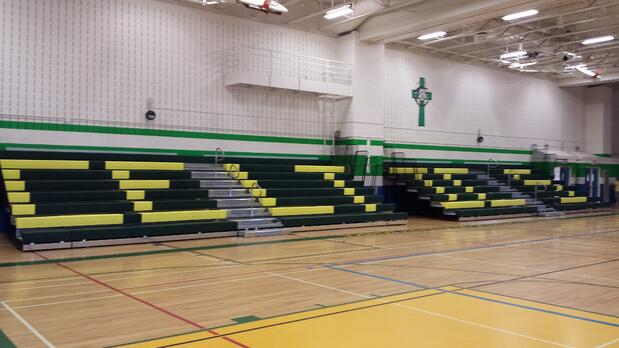 open-view-of-custom-colour-and-lettering-on-retractable-bleachers-st-david-CSS.jpg