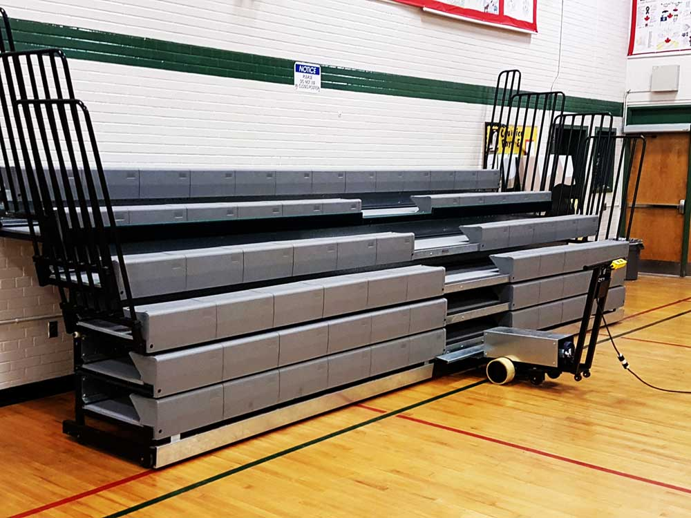 retractable-bleachers-with-tractor-operation