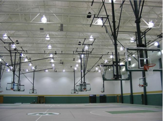 gym-with-ceiling-suspended-basketball-backboards.png