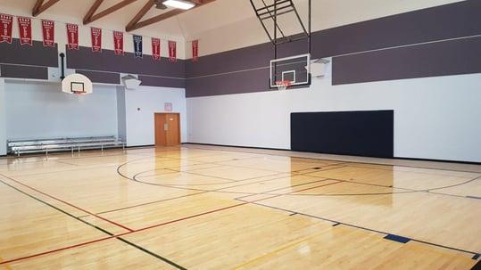 tip-and-roll-bleachers-and-custom-padding-under-basketball-nets.jpg