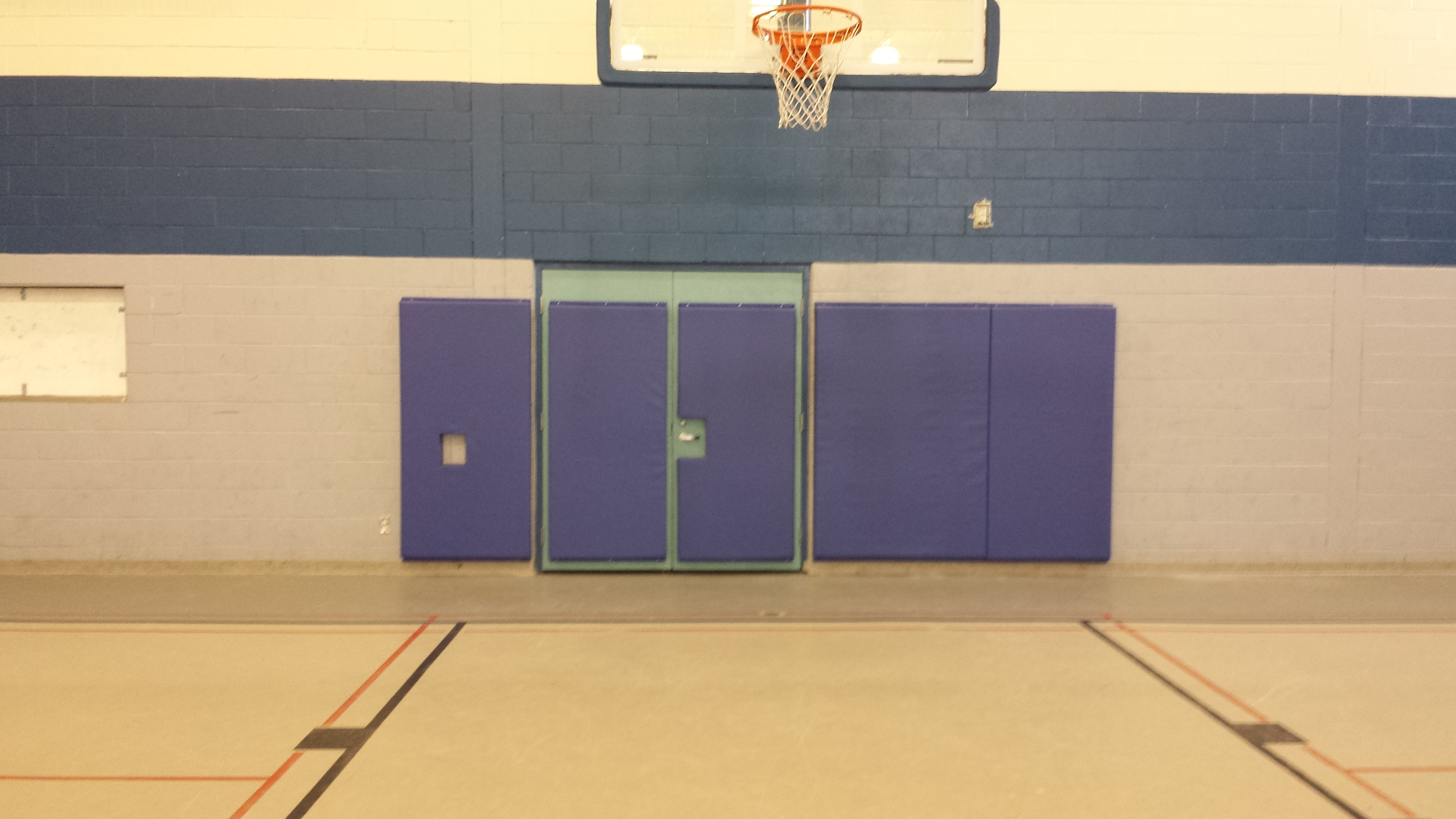father-ermanno-bulfon-community-centre-wall-and-door-padding